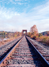 Railroad Bridge On The Connecticut River With Fall Foliage All Around