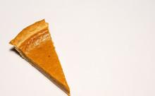 Pumpkin Pie Slice On White Background