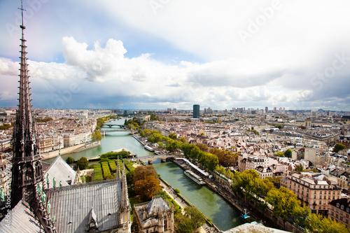 Fototapeta Old spire of Notre dame de Paris and Pont Sully obraz