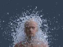 Young Man In Splash Of Water