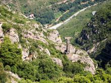 Rocky Slopes Of Montserrat, Covered With Dense Vegetation.