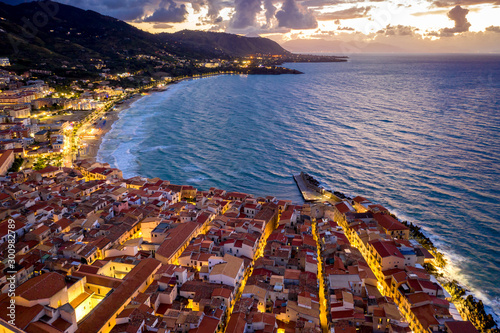 Foto auf Leinwand Braun Cefalu Sicily night town aerial view with the city lights and sunset sky . Italy, Tyrrhenian Sea