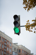Green Traffic Light On The Sky Background Closeup