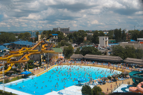 View of the pool in the water park from a height. bird flight. It's a nasty day. Summer holiday concept