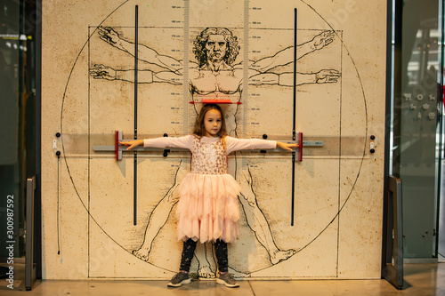 Little girl on the background of the Vitruvian man Canvas
