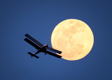 Airplane In The Sky And Moon