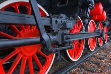 Fragment Of A Retro Locomotive On Railway,red Wheels Of The Black Locomotive