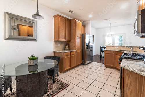 Bland Breakfast and Kitchen area with white tile, outdated Canvas Print