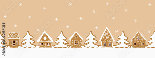 fototapeta na szkło Gingerbread village. Christmas background. Seamless border. There are gingerbread houses and fir trees on a caramel background. Greeting card template. Vector illustration