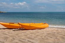 Two Colorful Orange Kayaks On ...