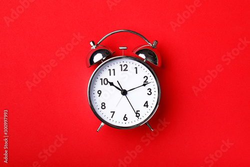 Photo Retro alarm clock on red background