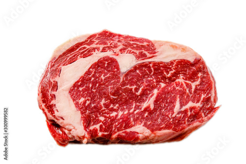 Garden Poster Steakhouse A rib eye steak of marbled grain-fed beef lies on a white background. Isolated.