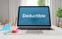 Deductible – Statistics/Business. Laptop In The Office With Term On The Display. Finance/Economics.
