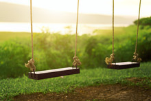 Children Swing In The Park