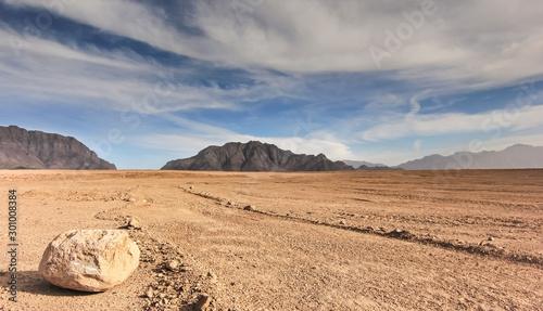 Fotografiet Afghanistan landscape, desert plain against the backdrop of mountains