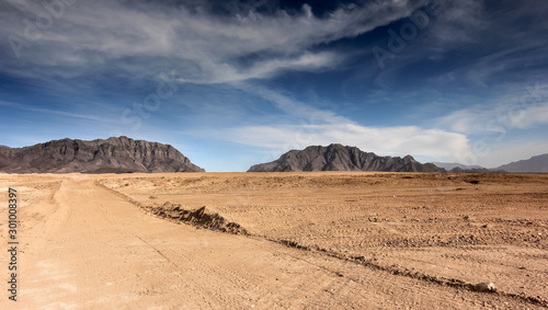 Afghanistan landscape, desert plain against the backdrop of mountains Wallpaper Mural