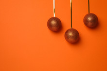 Christmas Balls On Orange Background, Space For Text