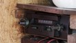 Male Hand changing Frequencies on an Old Radio Inside an Old Boat. Close-Up.
