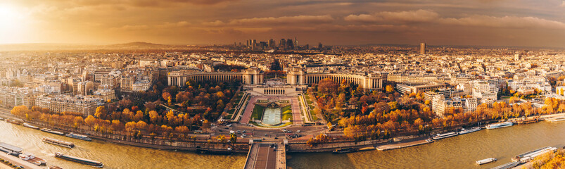 Aerial panorama of Paris City in late autumn from Eiffel Tower at sunset.