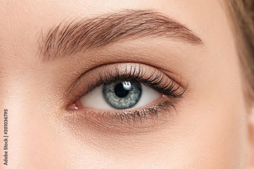 Fototapeta Young woman with beautiful eyebrows, closeup
