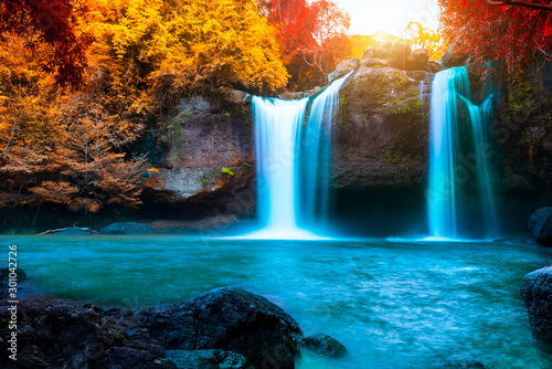 The amazing colorful waterfall in autumn forest blue water and colorful rain forest. - 301042726