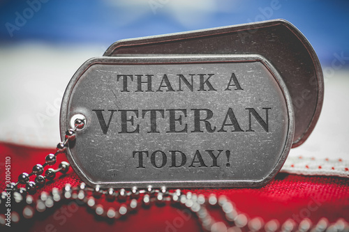 Recess Fitting Akt Worn US American dog tags on USA flag with Thank a Veteran Today engraved text