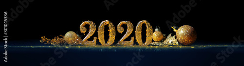 Fototapeta 2020 in sparkling gold numbers celebrating the New Year or Christmas with glittering ornaments and decorations obraz