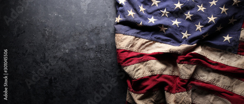 Obraz US American flag on worn black background. For USA Memorial day, Veteran's day, Labor day, or 4th of July celebration. With blank space for text. - fototapety do salonu