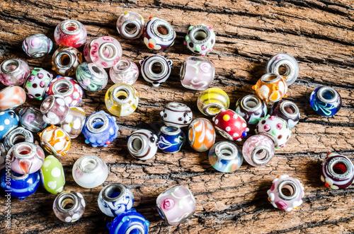 pandora bead on wood Tablou Canvas