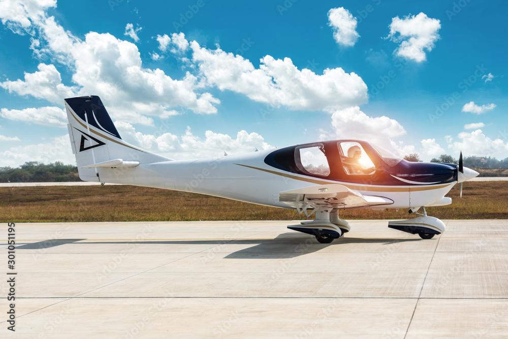 Fototapeta GA20 aircraft taxiing off on airport runway