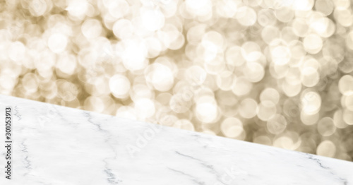 Obraz Empty white marbker angle table top with blur sparkling gold bokeh abstract background,panoramic banner for display or montage of product,Holiday seasonal concept backdrop. - fototapety do salonu