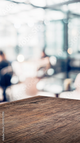 wood table product display background with blur people in cafe restaurant Canvas