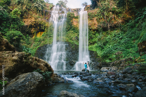 Deurstickers Bos rivier Travel to the most beautiful waterfalls, hard to find