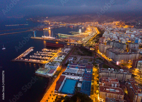 Aerial view of old town Almeria port and buildings at evening