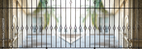 Valokuva Steel grating window on house veranda with outside view for security and beautif