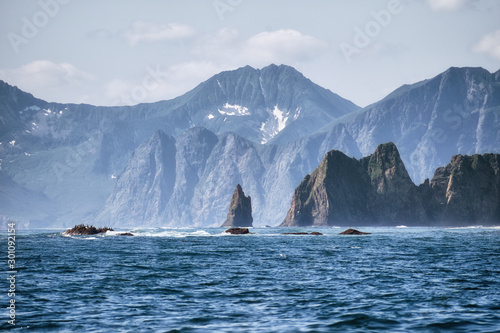 Autocollant pour porte Arctique Picturesque seascape of Kamchatka: scenery rocky islands in sea with waves