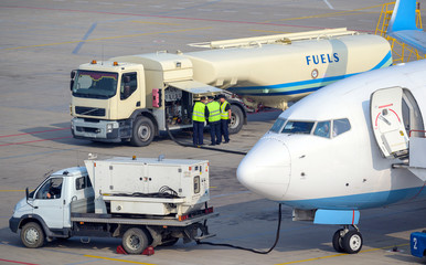 airport fuel prepare airplane vehicle flight gas