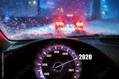 fototapeta na ścianę Going to the New Year 2020 by the car at snowy night