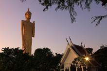 Burapha Phiram Temple And Big Buddha Or Buddha Rattanamongkol Mahamuni The Highest Standing Buddha Statue In Thailand In Roi Et Province, In The Twilight.