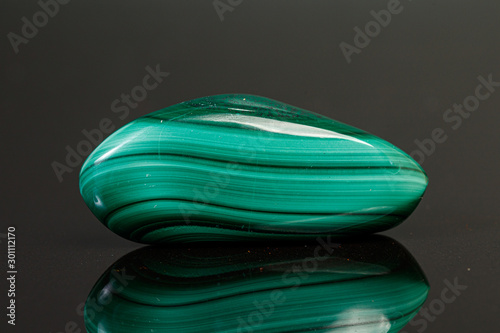 macro mineral stone malachite on a black background - 301112170