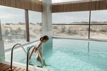 Girl Relaxing In Luxury Swimmi...