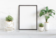 canvas print picture - Black frame leaning on white shelve in bright interior with plants and decorations mockup 3D rendering