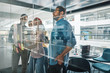 Diverse businesspeople brainstorming on a glass wall with sticky