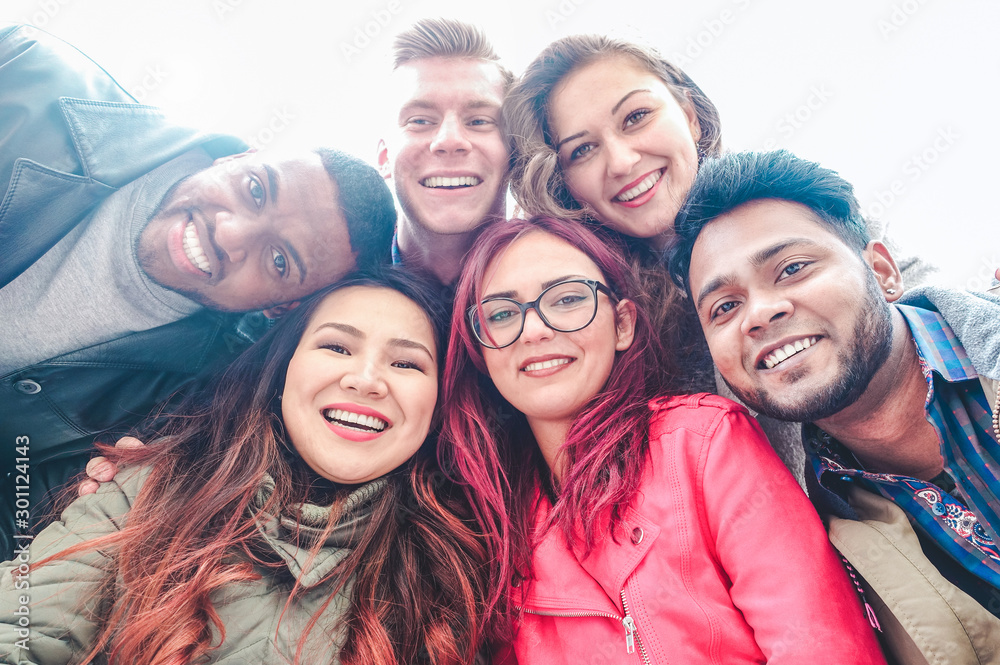 Fototapeta Happy friends from diverse cultures and races taking selfie - Students having fun with technology trends at erasmus university - Youth, tech and friendship concept  - Main focus on bottom girls