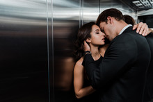 Beautiful Passionate Couple Hugging And Going To Kiss In Lift