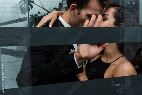 Fotografie, Tablou  beautiful passionate couple hugging and kissing in lift
