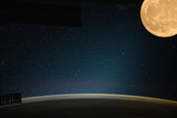Spaceship and moon above earth. The elements of this image furnished by NASA.
