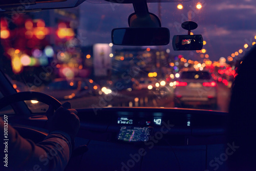 Foto auf AluDibond Nacht-Autobahn Driving a car in the city at night in traffic jams