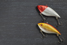 Two Fishing Lure Wobblers Closeup On Gray Wooden Background. Photo With Copy Space.