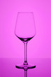 Leinwandbild Motiv Empty wine goblet on purple abstract vignette background